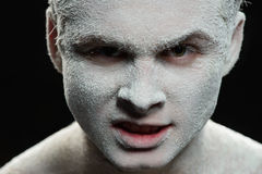 Handsome man with a white powder on the face Stock Photography