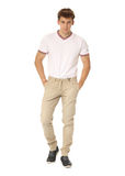 Handsome man in white shirt and beige pants isolated. Handsome man in white shirt and beige pants Stock Image
