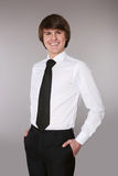 Handsome man in white shirt with black tie keeping hands in pock Royalty Free Stock Image