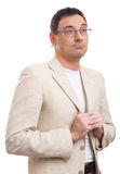Handsome man in white suit and glasses thinking Royalty Free Stock Photo