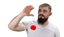 Handsome man in the white t-shirt holding red heart in his hand royalty free stock photos