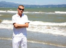 Handsome man in windiness on beach Riumar Spain Royalty Free Stock Photography