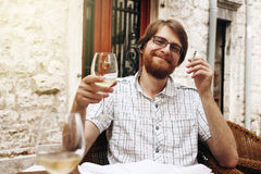 Handsome Man with Wine Glass in Street Cafe Stock Photo
