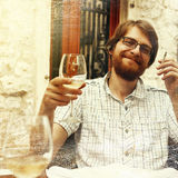 Handsome Man with Wine Glass in Street Cafe Royalty Free Stock Photos