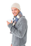 Handsome man in winter fashion holding mug Stock Images