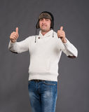 Handsome man in winter hat showing ok sign Stock Photos