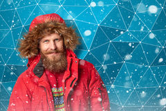 Handsome man in winter snow Stock Photography