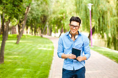 Handsome man wlaking in the park on a sunny day Stock Photo