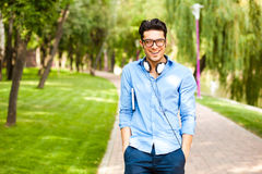 Handsome man wlaking in the park on a sunny day Stock Images