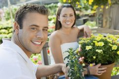 Handsome Man With Woman At Botanical Garden Stock Images
