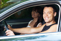 Handsome man and woman sitting car Stock Images