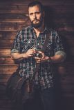 Handsome man in wooden rural house interior Royalty Free Stock Photo