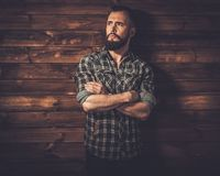 Handsome man in wooden rural house interior Stock Photos