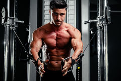 Handsome man work out in gym Stock Photos