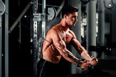 Handsome man work out in gym Stock Photo