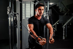Handsome man work out in gym Royalty Free Stock Photos