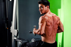 Handsome man work out in gym Stock Photography