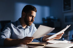 Handsome Man Working Alone at Night stock photo
