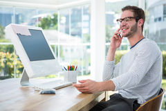 Handsome man working on computer and on the phone Stock Photo