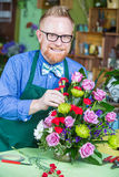 Handsome Man Working in Flower Shop Royalty Free Stock Photography