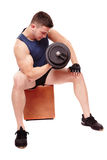 Handsome man working with heavy dumbbells Stock Photography