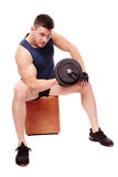 Handsome man working with heavy dumbbells Royalty Free Stock Image