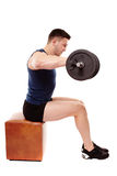 Handsome man working with heavy dumbbells Stock Image