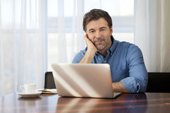 Handsome Man working At Home On His Laptop stock photos