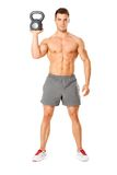 Handsome man working with kettlebell on white Royalty Free Stock Images