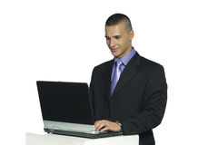 Handsome man working with laptop computer Stock Photo