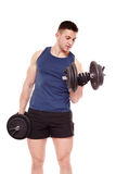 Handsome man working out with dumbbells Stock Photos