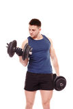 Handsome man working out with dumbbells Royalty Free Stock Photo