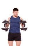 Handsome man working out with dumbbells Stock Photo