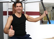 Handsome man working out in a gym Stock Photo