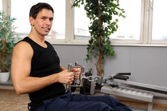 Handsome man working out in a gym Stock Image
