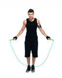Handsome man working out with skipping rope Royalty Free Stock Photos