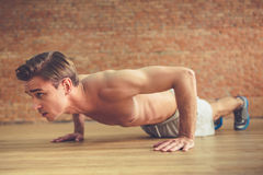 Handsome man working out Stock Photos
