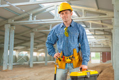 Handsome man with working tools Stock Image