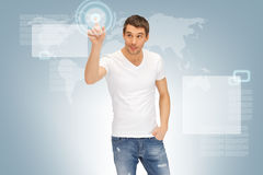 Handsome man working with touch screen Royalty Free Stock Photos