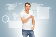 Handsome man working with touch screen Stock Image