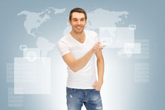 Handsome man working with touch screen Royalty Free Stock Photography