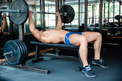 Handsome man workout with barbell Royalty Free Stock Image