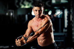 Handsome man workout in gym Royalty Free Stock Images