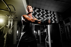 Handsome man workout in gym Stock Photos