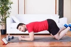 Man doing push ups at home royalty free stock images