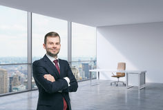 A handsome man in a workplace at modern corner panoramic office in New York, Manhattan. A concept of financial consulting Royalty Free Stock Photo