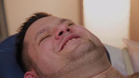 Handsome man writhes in pain. Handsome man writhes in pain stock footage
