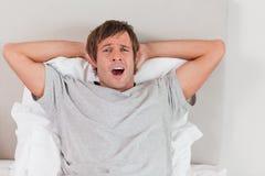 Handsome man yawning Stock Image