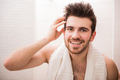 Handsome man. Handsome young man is looking at the mirror and smiling Stock Image