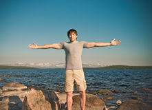 Handsome Man young standing Outdoor hands raised Stock Photography